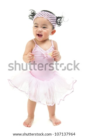One year old Asian baby girl standing over white background - stock photo