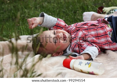 One year old baby at picnic - stock photo