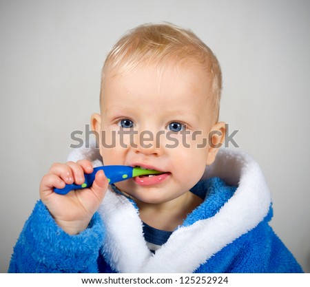 One year old baby boy with tooth brush - stock photo