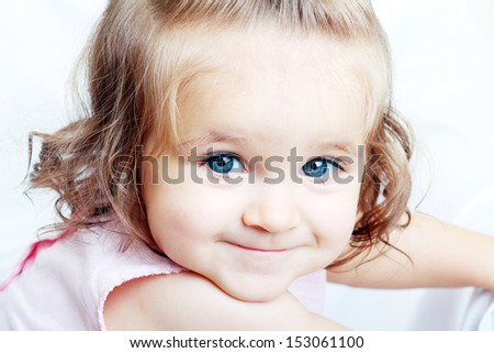 One Year Old Baby Girl Sitting on Floor Smiling Isolated on White Background - stock photo