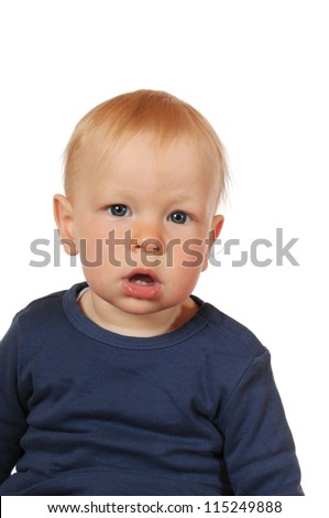 One year old boy in front of a white background