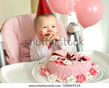 one-year-old little girl solemnize birthday, happy laughter, horizontal photo - stock photo
