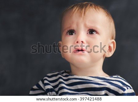 One year toddler afraid something ore someone and looking up - stock photo