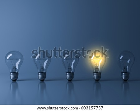One yellow glowing light bulb standing out from the unlit incandescent bulbs on dark blue background with reflection and shadow , individuality and different creative idea concepts . 3D rendering.