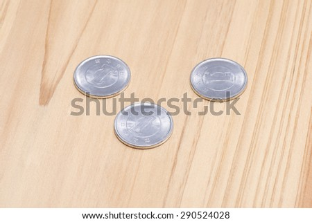 one yen on wooden table - stock photo