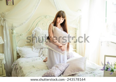 one young girl on the bed