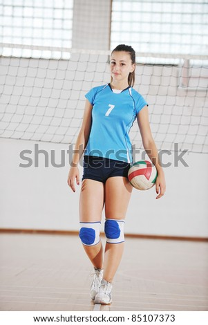 one young girl playing volleyball game sport  indoor - stock photo