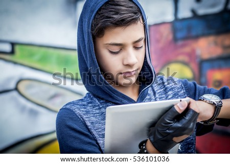 One young man boy holding looking stock photo 536101036 shutterstock one young man boy holding looking at tablet pad computer present touch screen isolated graffiti voltagebd Images