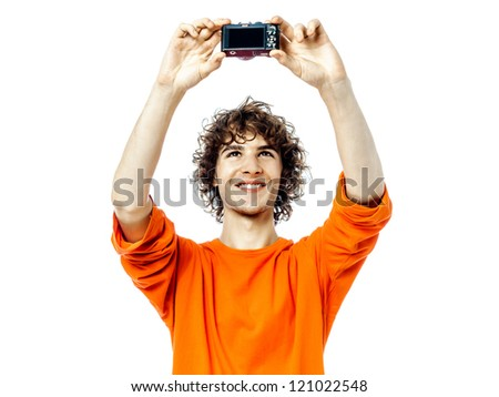 one young man caucasian holding camera photographing portrait  in studio white background - stock photo