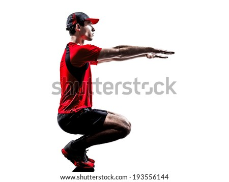 one young man runner jogger stretching warming up in silhouette isolated on white background - stock photo