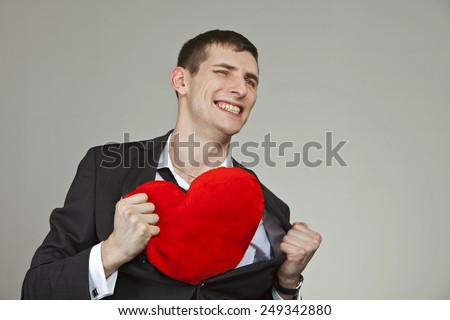 one young man with a red heart - stock photo