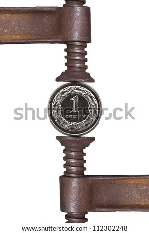 one zloty coin pressing in iron press isolated on white background - stock photo