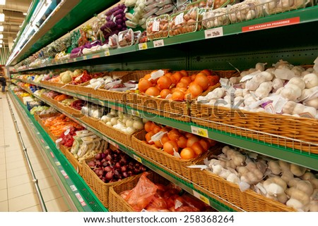 Onion and garlic on supermarket shelves, no trademarks - stock photo