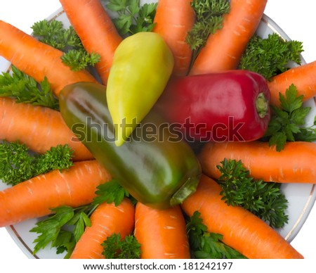 Onion in the center of the plate and carrots together with the parsley. Presented on a white background.