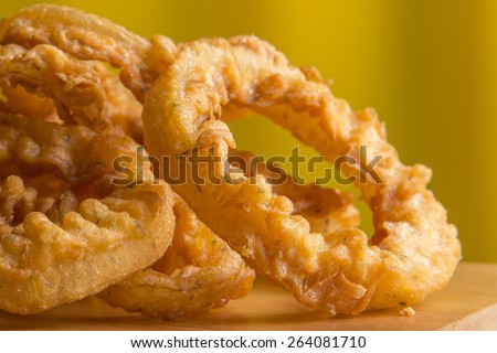 onion rings served on wood platter  - stock photo