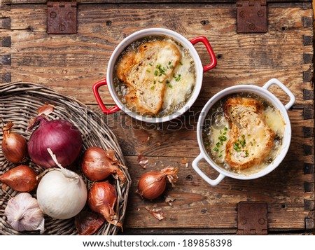 Onion soup with dried bread and cheddar cheese - stock photo
