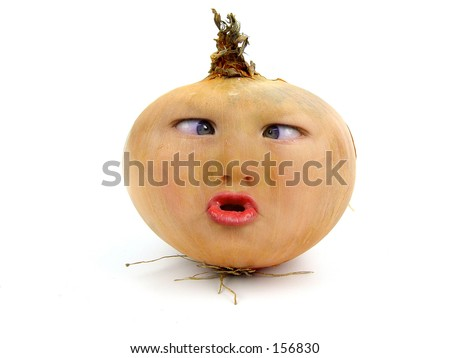 Onion with a funny face - stock photo