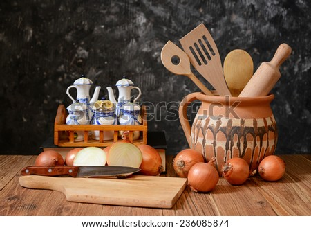 Onions and accessories for cooking food on the table - stock photo