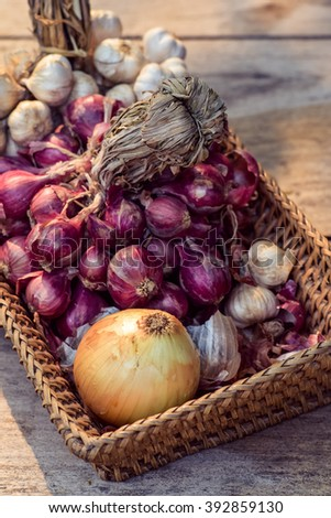 Onions and garlic on the  basket wood
