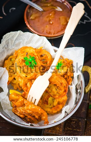onions  bhaji with mango chutney. Indian cuisine. selective focus. the image is tinted - stock photo