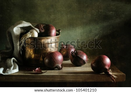 Onions in a copper bucket - stock photo