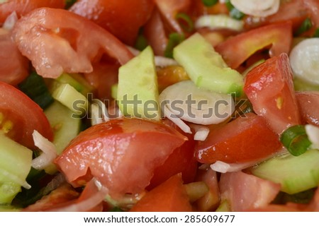 onions in a salad with tomatoes and cucumbers