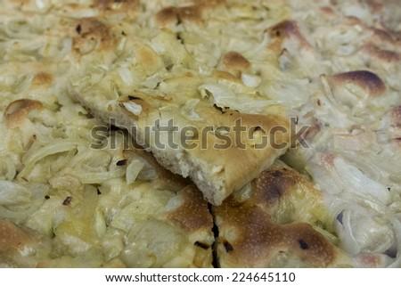 onions liguria focaccia in a bakery - stock photo