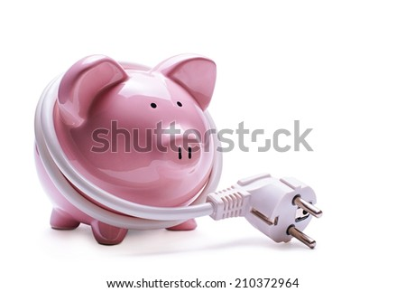 Online banking and savings concept with a pink ceramic piggy bank standing coiled in a white computer cord and plug isolated on a white background