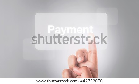 online banking concept, hand pressing payment button with gray background