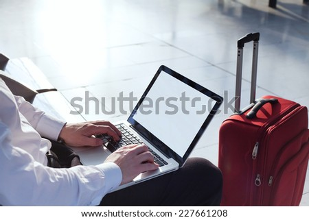 online banking on internet in business travel, laptop with empty screen - stock photo
