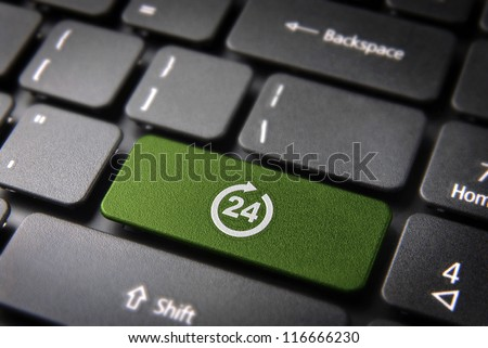 Online business always open concept: green key with 24 working hours symbol on laptop keyboard. Included clipping path, so you can easily edit it. - stock photo