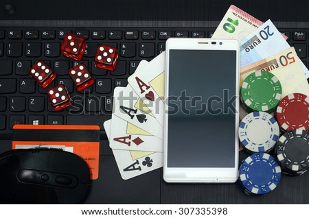 online casino games concept computer and smart phone - stock photo