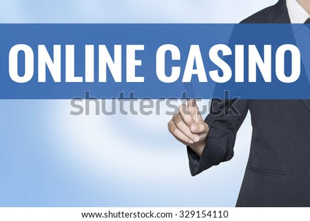Online Casino word on virtual screen touch by business woman blue background - stock photo