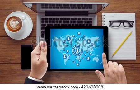 Online Community, on the tablet pc screen held by businessman hands - online, top view - stock photo