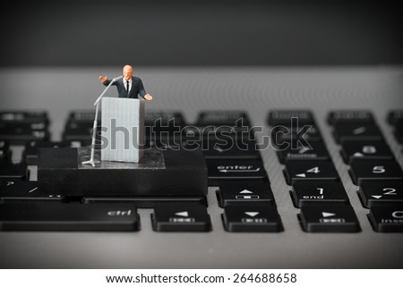 online conference concept-miniature speaker at Business Conference on laptop computer - stock photo