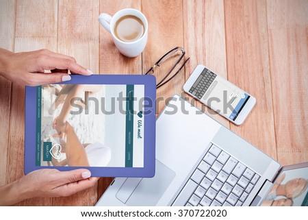 Online dating app against overhead of feminine hands holding tablet - stock photo
