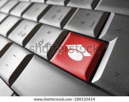 Online education and e-learning concept with graduation cap icon and symbol on a red computer key for school and online educational business.