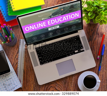 Online Education Concept. Modern Laptop and Different Office Supply on Wooden Desktop background. - stock photo