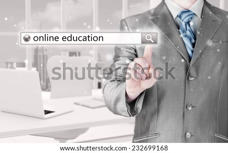 Online education written in search bar on virtual screen. - stock photo