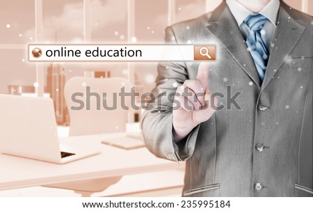 Online education written in search bar on virtual screen. - stock photo