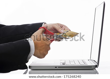 Online Financial Planning Concept-Executive Hand Cutting credit card over white backgound - stock photo