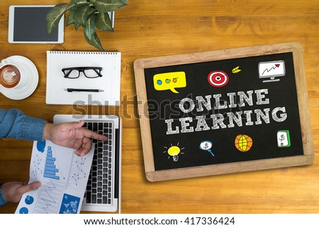 ONLINE LEARNING Businessman working at office desk and using computer and objects, coffee, top view, - stock photo