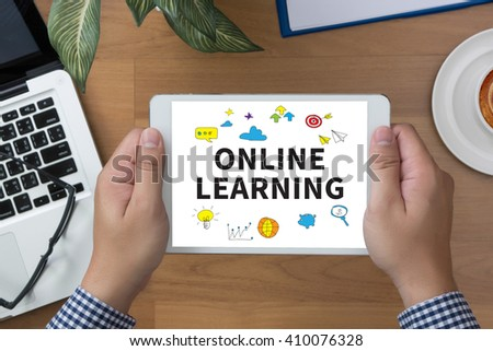 ONLINE LEARNING man hand Tablet and coffee cup - stock photo