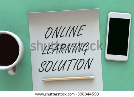 ONLINE LEARNING SOLUTION, 3D rendering message on paper, smart phone and coffee on table - stock photo