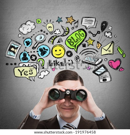 Online life concept. Business man looking through binoculars. Bright sketches overhead.  - stock photo