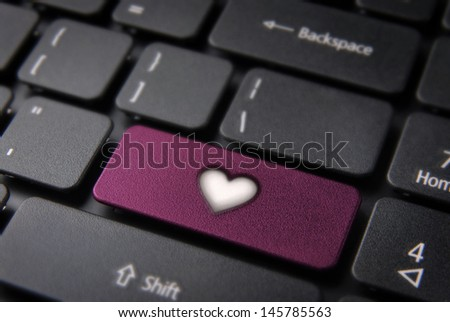 Online Love concept key with heart icon on laptop keyboard. Included clipping path, so you can easily edit it.