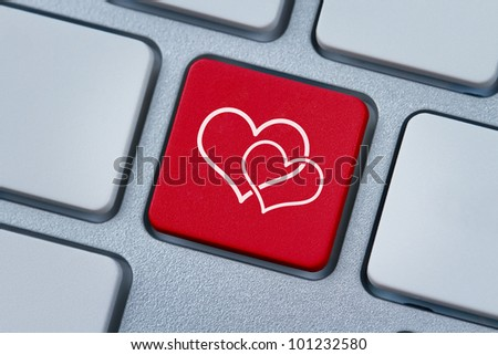 Online love, two hearts symbol at the computer key - stock photo