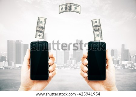 Online money transfer concept with two male hands holding smart phones with blank screens and dollar bills above on city background. Mock up, 3D Rendering - stock photo