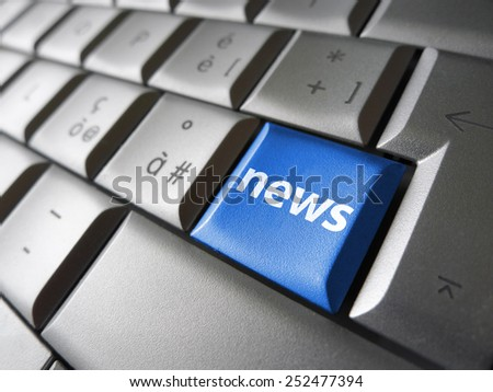 Online news Internet concept with news sign and symbol on a blue laptop computer key for blog, website and online business. - stock photo