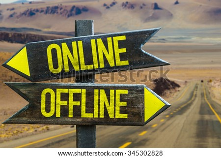 Online - Offline signpost in a desert road background - stock photo